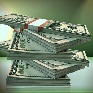 stacks of cash describing the Banking Secrecy Act