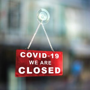 COVID-19 Closed Sign in window of business